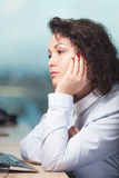 Bored at work. Bored and unhappy woman at work royalty free stock photography