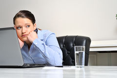 Bored at work woman Royalty Free Stock Image