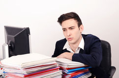 Bored and worried business man with a lot of work. Royalty Free Stock Photography