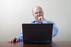 Bored yawning businessman Royalty Free Stock Photography
