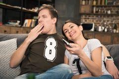 Bored yawning man and smiling woman Stock Photo