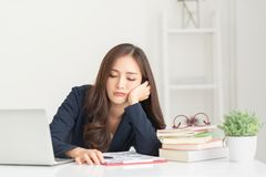 Bored young Asian woman working stock images