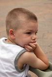 A bored young boy Royalty Free Stock Photo