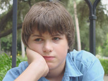 A Bored Young Boy. A photograph of a bored young boy Royalty Free Stock Photos
