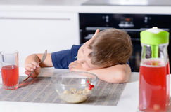 Bored young boy waiting for his meal Royalty Free Stock Image