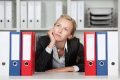 Bored Young Businesswoman With Binders Stock Image