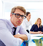 Bored young executive gesture multi ethnic meeting Royalty Free Stock Photos