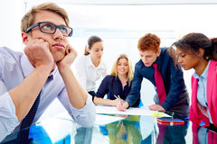 Bored young executive gesture multi ethnic meeting Royalty Free Stock Photography