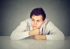Bored young man daydreaming showing no interest Stock Photo