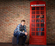 Bored young man waiting for his wife Royalty Free Stock Photos