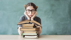 Bored young student girl with books. Bored young student girl with  books royalty free stock image