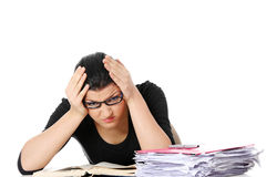 Bored young student woman at the desk Stock Photography