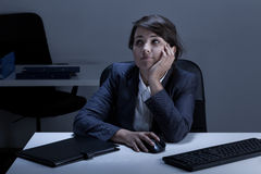 Bored young woman in the office Royalty Free Stock Photo