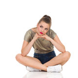 Bored Young Woman Sitting And Lookign Away Royalty Free Stock Photography