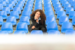 Bored young woman sitting waiting Stock Photo