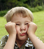 Boredom. Young child scrunches up his face in boredom Stock Images