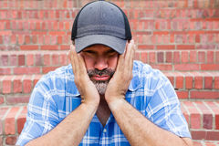 Boredom - the enemy of human happiness. Boredom, the enemy of human happiness in a conceptual image of a middle-aged man with a goatee sitting resting his chin Royalty Free Stock Image
