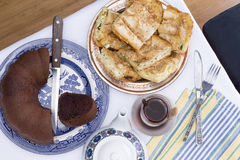Borek and chocolate cake served at a party Royalty Free Stock Images