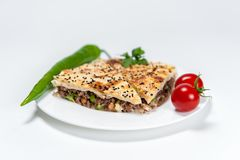Borek with Meat and Vegetables on white plate stock image