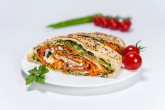 Borek with vegetables on white plate / section stock photo