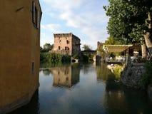 The River Mincio in Borghetto near Valeggio sul Mincio. Borghetto is a village in the municipality of Valeggio sul Mincio, in the province of Verona. It is Stock Images
