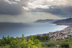 Borgio, liguria landscape. View of the sea and town, mediterranean coastline, cloudy day, mountains in background Royalty Free Stock Images