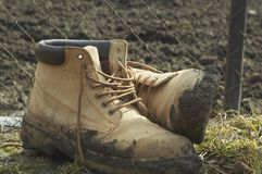 Borgue. Dirty boot near then workplace royalty free stock image