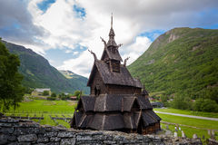 Borgund Stave Church and mountain background Stock Photography