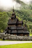Borgund stave church stavkyrkje in Norway. In misty cloudy weather in a portrait orientation royalty free stock photos