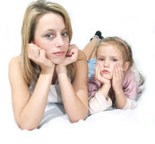 Boring. Mother and child sleepy lay on the bad Stock Images