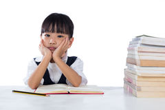 Boring Asian Chinese little girl wearing school uniform studying Stock Photo