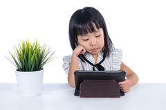 Boring Asian Chinese little office lady holding tablet Royalty Free Stock Image