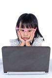 Boring Asian Chinese little office lady using laptop Stock Photo