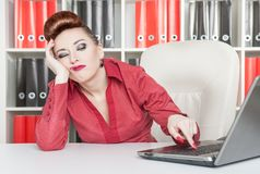 Boring business woman working at office. With computer stock photography