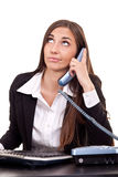 Boring call. Businesswoman having boring call in office royalty free stock photography