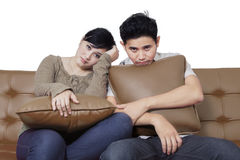 Boring couple sit on the sofa Royalty Free Stock Photography