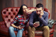 Boring couple sitting on sofa Stock Images