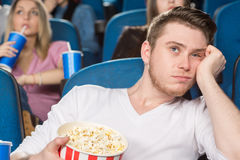 Boring day at the movies Royalty Free Stock Images