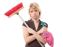 Boring housework. Bored woman blows while making housework royalty free stock image