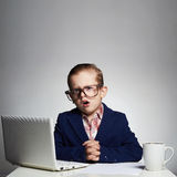 Boring job.Young business boy.child in glasses. little boss in office Stock Image