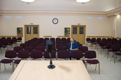Boring lecture. Alone sleeping student in empty auditorium royalty free stock images