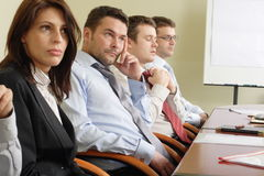 Boring meeting. Group of business people at long boring meeting royalty free stock images
