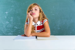 Boring sad expression student schoolgirl on desk Royalty Free Stock Photography