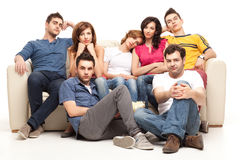 Boring and sad movie. Young gathering of friends watching boring sad movie Royalty Free Stock Image