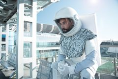 Mindful male astronaut in wait Royalty Free Stock Photography