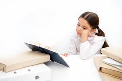 Boring task homework. Get rid of boring task. Girl bored pupil sit at desk with folders and books. Issues of formal stock image