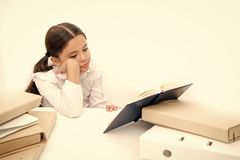 Boring task homework. Get rid of boring task. Girl bored pupil sit at desk with folders and books. Issues of formal royalty free stock photography