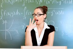 Boring teacher. Educational theme: portrait of a teacher giving a lecture royalty free stock photography