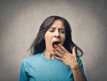 It is boring. Woman shows that it is boring Royalty Free Stock Image