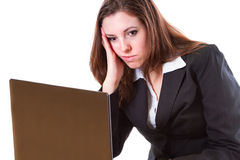 Boring woman working on the laptop Stock Photo